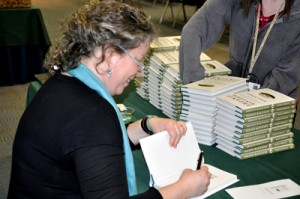 Signing copies of <em>Organic Manifesto</em>