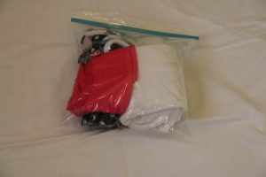 Fold up swim gear and put into a plastic bag. Toss into beach bag. And when you leave the beach, throw the wet items in the baggie.